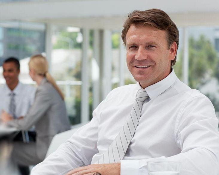 sitting smiling business man
